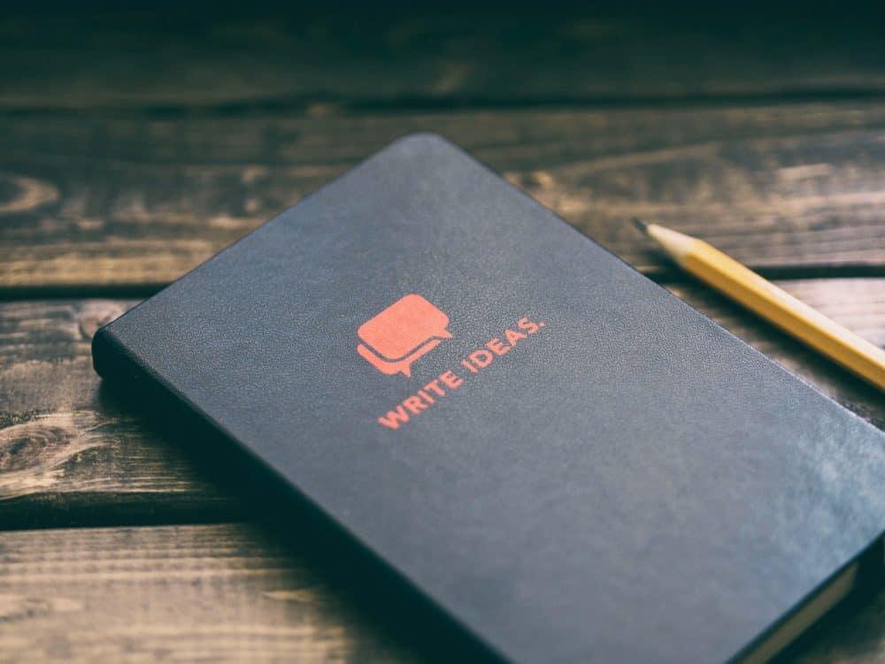 Cahier de note avec un crayon a papier